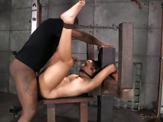 Restraints deriving from bondage might intensify pain and pleasure. Tinslee is wearing a ball gag and her hands are strongly tied up. The helpless bru