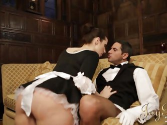 Instead of doing their jobs french maid Paige and butler Demetri are acting very naughty. He takes a sit on the couch and the maid begins taking care