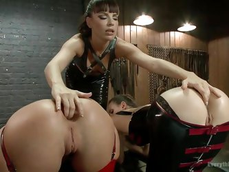 There's no butts when Dana wants to punish her naughty girls! she putted them both to stay bent over and fingered their assholes nice and deep. A