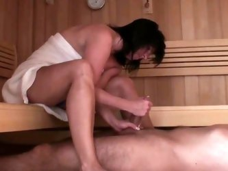 Footjob in sauna