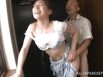 She's standing by the window when her man comes along to open her blouse and suck on her nipples. She loves it and loves the fact she is being fi