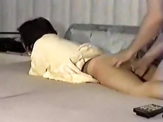 Hot housewife is laying on the bed with her ass and back in my direction. I start to finger fuck her and fondle her ass as I take a home made porn mov