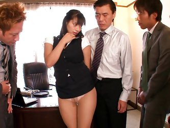 The arrival of an attractive Asian slut in the office is a reason of excitement in the department. Four horny colleagues gather to benefit from her fa