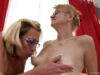 These saggy, old sluts are misbehaving again! Beata and Milli suck each other's nipples and then Milli lays on her back, spreading her thighs. Th