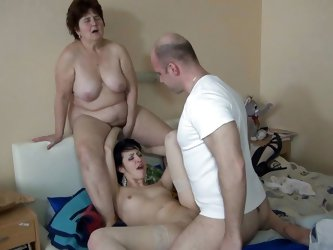 This whore is a lot more younger then her granny and she stays with her legs spread for the guy to fuck her pussy. Granny Hanna watches them and even