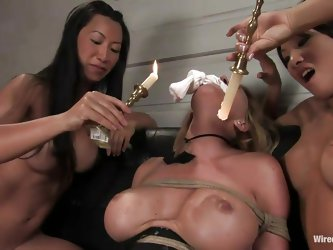 Krissy needs some intense punishment and these asian whores show her what they are capable of. After pouring hot wax on her big round boobs and on her