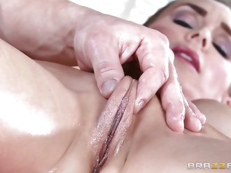 This woman is sore all over, but the masseur will help fix that. He pinches her pussy lips together and works the rest of her body with oil. This turn