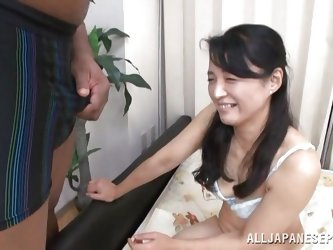 She's Nippon and she's mature! Check it out how this slutty Japanese brunette as a taste of black cock. She had a lot of dick at her time bu