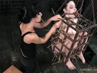 That's what she deserves for being a fucking whore. Brunette milf Dixon is now in a small bondage cage and her mistress shows her no mercy as she