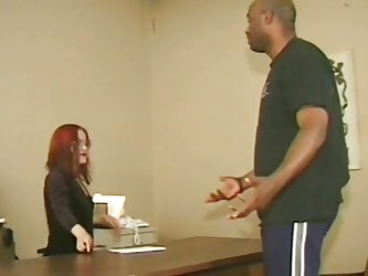 Cute redhead midget asks this tall big black guy to stand up and then takes his cock in her mouth, wrapping those red sexy lips around it. This is at
