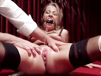 The slave is tied down to the billiard table and the master takes the cue and shoves it deep into her cunt. The cue is covered in pussy juice because