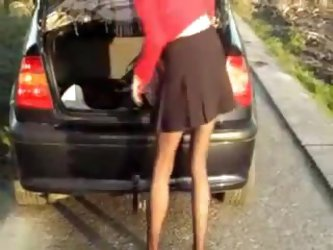 Amateur mature movie show a horny slut in a short skirt getting filmed outdoor by her excited husband as she rides a huge black dildo and moans loudly