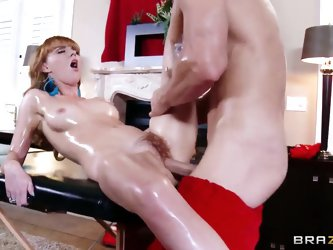 Sweet redhead chick Marie McCray gets her slender body oiled intense by a hot Santa and gets her pussy stimulated with a vibrator. After that he start