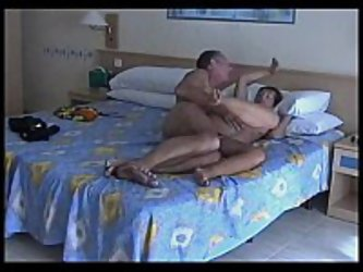 Older tanned couple has sideways sex on their vacation. They barely get the time to go to the beach from all the sex they are having. They put much of