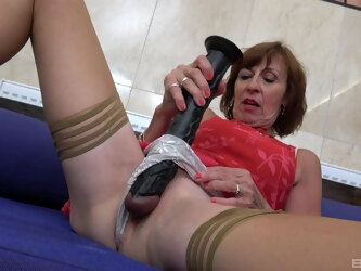 Dirty solo granny Dana Beranova inserts large toys in her cunt