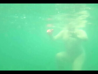 Chrissi is swimming nude in the Mediterranean