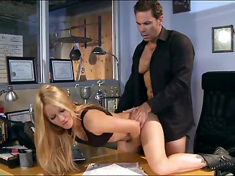 Jessica Drake is a perfect bodied milf with long legs and round boobs. Stacked blonde in black boots gets her wet pussy eaten out and banged on a desk