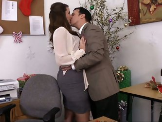 Paige Turnah and her co-worker Anthony escape the company Christmas party and run back to the office for a few mistletoe smooches. Anthony reminds her