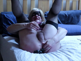 tranny inserting large anal beads and talking