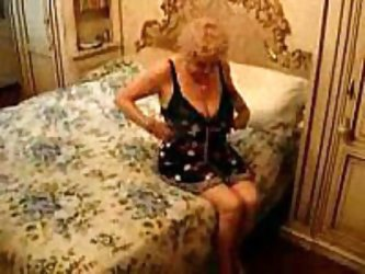 Old granny still wants to fuck in this homemade amateur fuck video clip. She has big saggy tits that she fondles as she waits for her husband's c