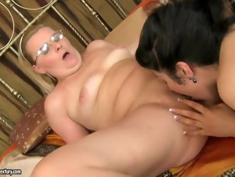 Experienced mature blonde Madeline with natural tits and big juicy ass has awesome licking and fingering session with young slender black haired babe