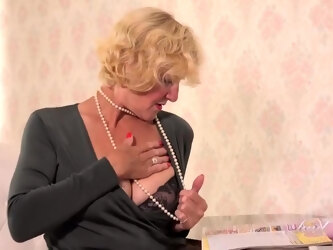 Mature blonde woman with big boobs, Molly Maracas likes to masturbate while alone at home