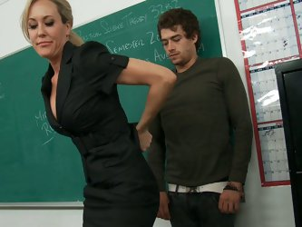 Xander comes into Prof. Love's classroom to find her groggy and sleepy. It seems her boyfriend kicked her out of her place and she is now actuall