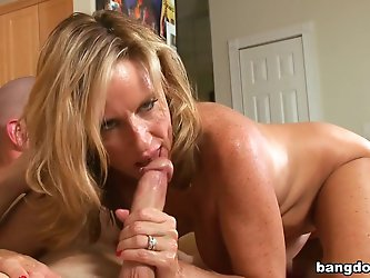 Jodi West is a sexy Milf! And she's in need of a good fucking by some young mans cock. Her hubby's out of town and she hot and horny. Jodi W