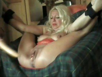 This busty cougar spread her legs to show me her gaping cunt and asshole. I drilled her love holes with a sex toy in this private fetish homemade clip