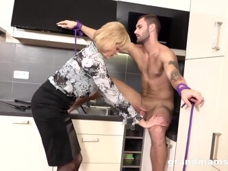 Blonde Granny Is Eagerly Sucking A Younger Guys Dick And Getting Fucked Hard, In The Kitchen
