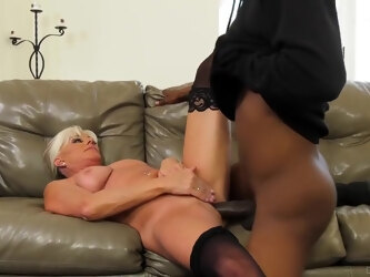 Experienced, blonde granny, Payton Hall is giving a blowjob to a black guy, Slim Poke, before sex