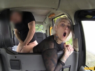 Blonde slut Tallulah Tease takes a dick in her rear end in the taxi