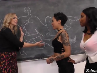 Lusty lesbians are having an interracial threesome in the classroom, while no one is watching them