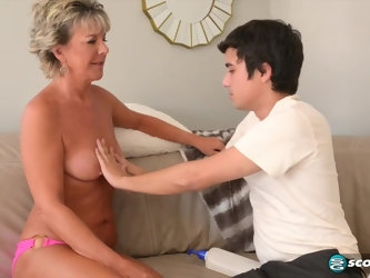 Dirty mature woman knows how to please a young guy who has a huge cock