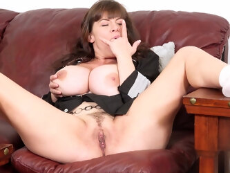 Sexy mature teacher exposes her huge tits while preparing for work