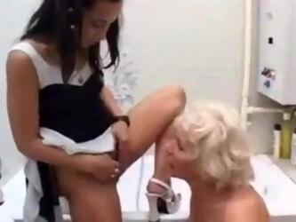 Young girl pisses in granny's mouth