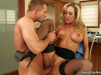 Big boobed Brandi Love hires a guy for male escort service and gives his hard dick a try in the comfort of her kitchen. She's s sexy mature woman