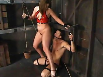 A sadistic mistress has a slave captive in the basement of her house. The helpless guy has been awfully tied up and bonded. The slutty milf takes off