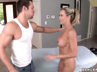 Brandi Love is a mature woman with perfect body and big tits, after yoga she needs to relax and her friend helps her making erotic massage with sweet