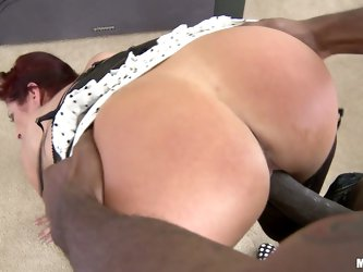Good looking red-haired milf Tiffany Mynx with nice ass takes big black dick. She gives head to her dark skinned fuck buddy and then gets shagged dogg