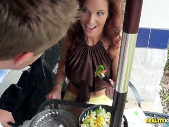 Attractive hungry for fuck redhead milf with tight sexy body and juicy boobs in provocative skirt try to seduce young blonde handsome stud while havin