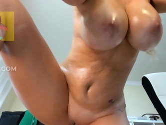 Big tits mature fingers her bald pussy and squirts
