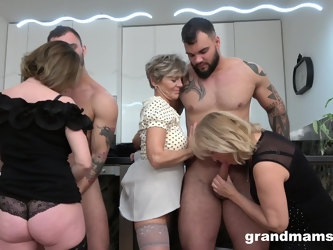 Foursome fucking on the floor with two dirty mature amateurs