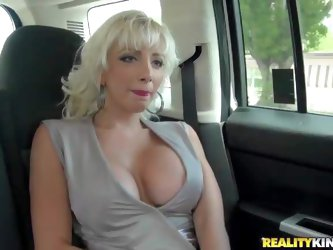 THis white haired elegnat milf is a heartbreaker. White haired flirtatious woman with huge boobs goes topless in front of lucky MILF Hunter. He loves