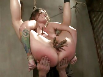 Slutty milf Missy is all tied up in the air and her executor starts torturing her tits and pussy with a lot of clothespins. Then, he spanks her ass ti
