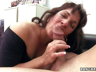 Dark haired and really turned on milf with big boobs has fun in giving head on her knees in the back room during her porn movie casting and enjoys in