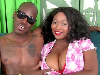 Busty ebony MILF Marie Leone takes on a huge black anaconda