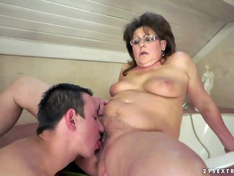 Short haired chubby brunette granny with natural hanging knockers gets her hairy twat licked and boned good by young horny pool boy with long shaft in