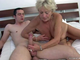 Agw wrinkled blonde Malya is naked and ready for sex with young hard dicked guy. She gives headjob and then takes his meat pole up her loose experienc