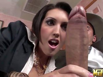 Busty brunette MILF Dylan Ryder in white blouse and black smart suit pulls out cowboy's sausage. He surprises her with his cock size. She admires